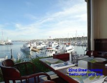 Photo of 22nd Street Landing Seafood Grill & Bar overlooking marina